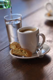 Pouring water and espresso Royalty Free Stock Photography