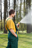 Pouring water with garden hose Royalty Free Stock Photo
