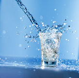 Pouring water into glass Stock Photography