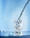 Pouring water into glass Royalty Free Stock Images