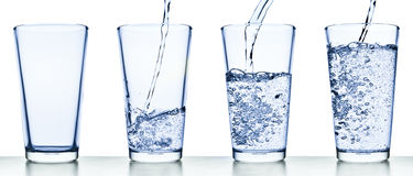 Pouring water into glass Royalty Free Stock Photos