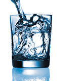 Pouring water in glass Royalty Free Stock Photography
