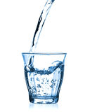 Pouring water in glass Royalty Free Stock Images