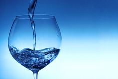 Pouring water into glass Royalty Free Stock Photo