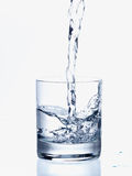 Pouring Water in a Glass Stock Images