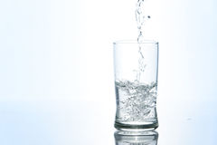 Pouring water in glass Stock Photography