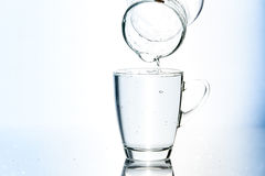 Pouring water in glass Stock Photos