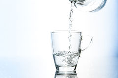 Pouring water in glass Stock Photo
