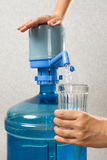 Pouring water into glass from bottle with a pump stock images