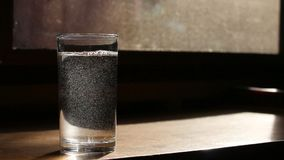 Pouring water into glass. Close up pouring water into glass stock footage