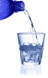 Pouring water on a glass Royalty Free Stock Photos