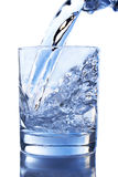 Pouring water on a glass Royalty Free Stock Image