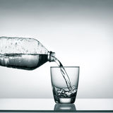 Pouring water into glass Stock Photos