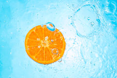 Pouring water on an organic Tangerine Stock Photography