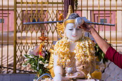 Pouring water / showering or watering buddha with water and ince Stock Photography
