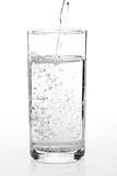 Pouring water to a glass Royalty Free Stock Photos