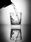 Pouring water to glass Stock Photography