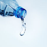 Pouring water from water bottle Royalty Free Stock Images