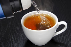 Pouring water for your tea cup Royalty Free Stock Photography