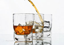 Pouring whiskey Royalty Free Stock Image
