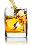 Pouring whiskey Stock Image