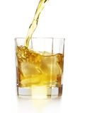 Pouring whiskey. Whiskey pour into the glass over white background stock photo