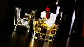 Pouring whiskey on bar table lounge bar atmosphere. Barman pouring whiskey on bar table lounge bar atmosphere stock footage