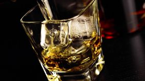 Pouring whiskey on bar table lounge bar atmosphere stock video footage
