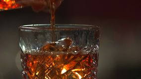 Pouring whiskey, close up. stock footage