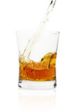 Pouring whiskey in glass Royalty Free Stock Photo