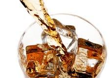 Pouring whiskey into glass Stock Photos
