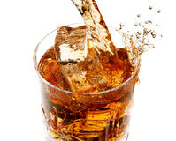 Pouring whiskey into glass Royalty Free Stock Image