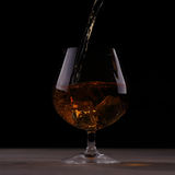Pouring whiskey into glass Royalty Free Stock Photography