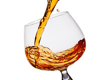 Pouring whiskey in glass Royalty Free Stock Images