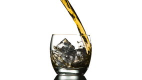 Pouring Whiskey on Ice stock video