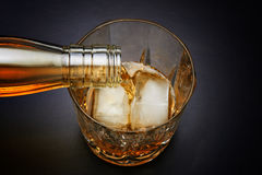 Pouring whiskey in nice glass Stock Image