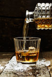 Pouring Whiskey or Scotch Royalty Free Stock Photos