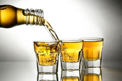 Pouring whiskey Stock Photography