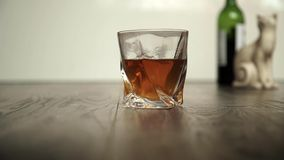 Pouring whiskey in two glasses Stock Photography