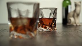 Pouring whiskey in two glasses Royalty Free Stock Photography