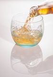 Pouring whisky into a glass Royalty Free Stock Photos