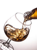 Pouring whisky into a glass Stock Photography