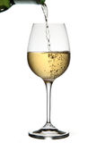 Pouring white wine royalty free stock photos