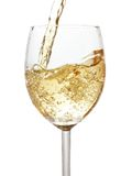 Pouring white wine. Isolated over whte background stock photos