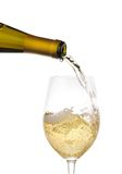 Pouring white wine. In a glass. Close up Stock Photography