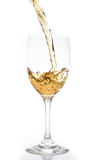 Pouring of white wine Royalty Free Stock Photography