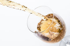 Pouring of white wine Royalty Free Stock Images