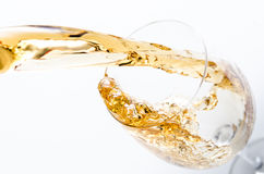 Pouring of white wine Stock Photos