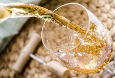Pouring of white wine Royalty Free Stock Image