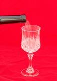 Pouring white wine Stock Photos